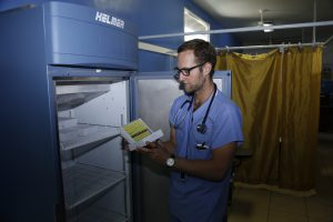 Trevor Brooks examines samples from his study. The freezer was provided as a donation to the Public Hospital Roatán by Helmer Scientific.